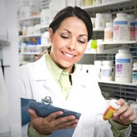 Pharmacist With Medicine Smiling